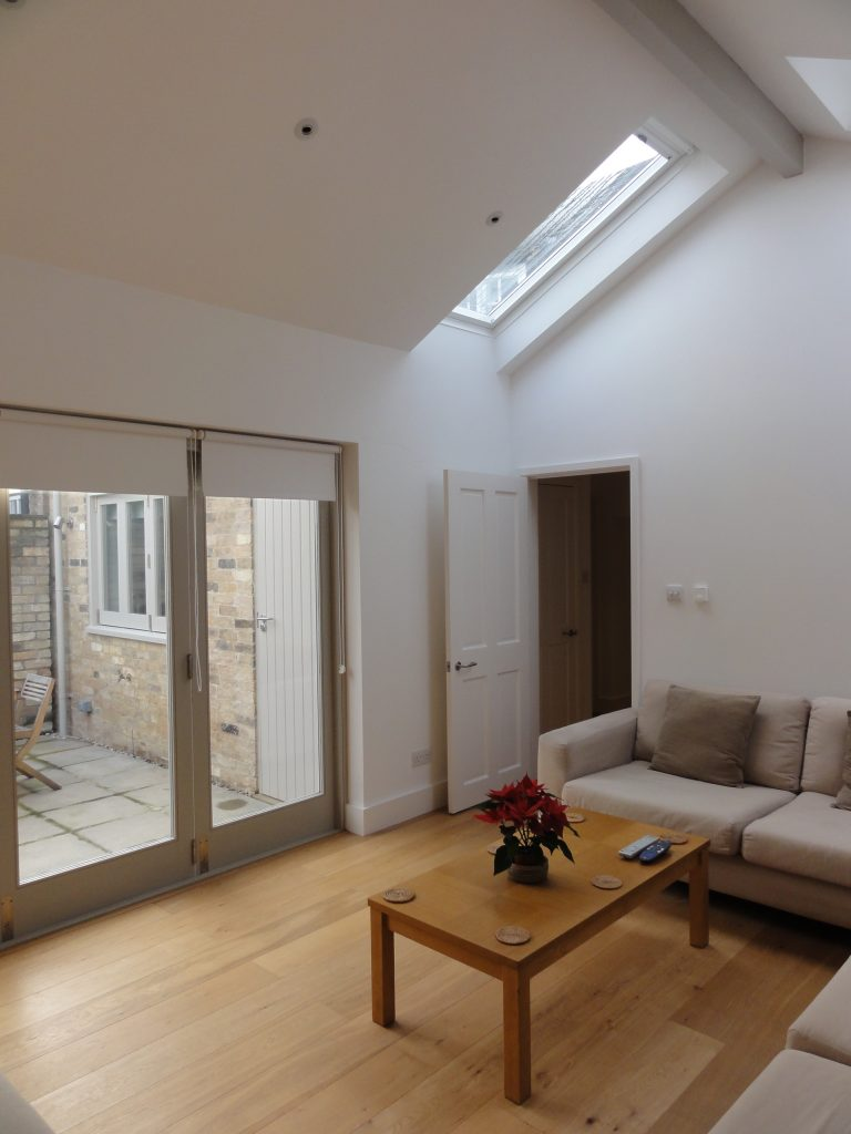 Rooflights in a lounge extension of a grade II listed cottage