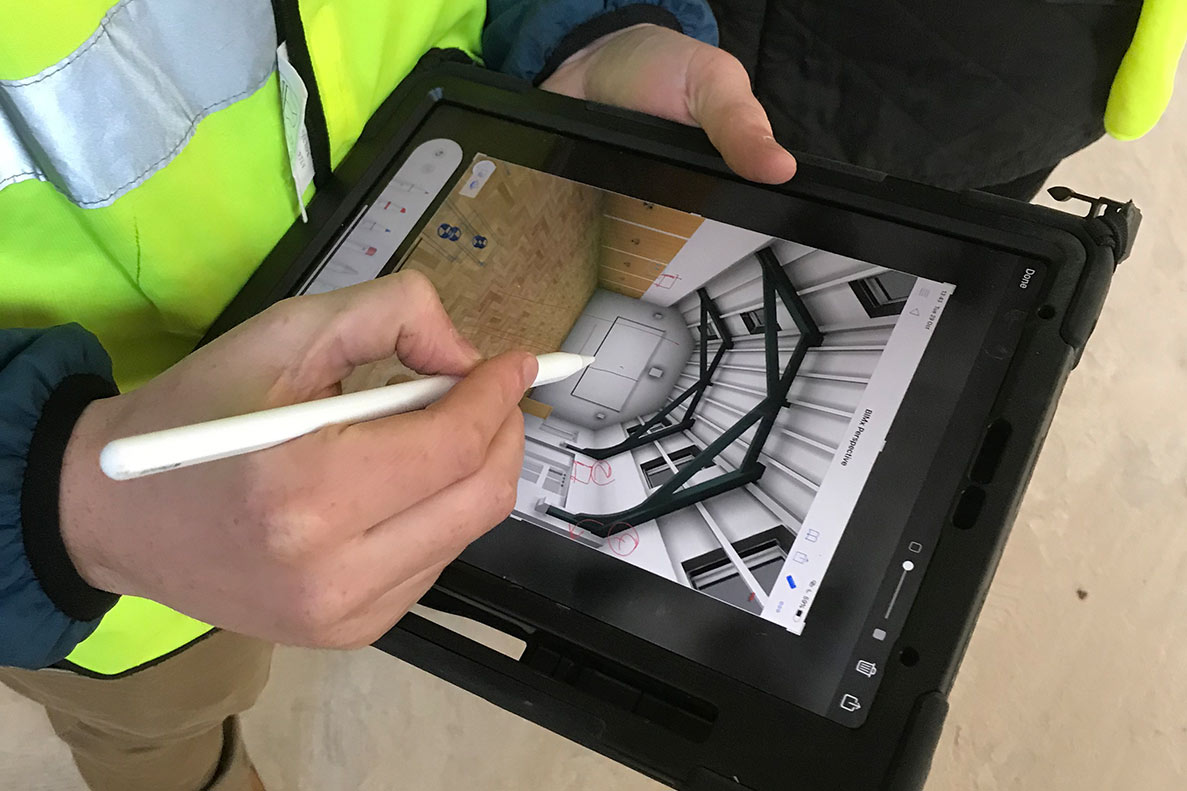Architect using 3d drawing model on site with ipad