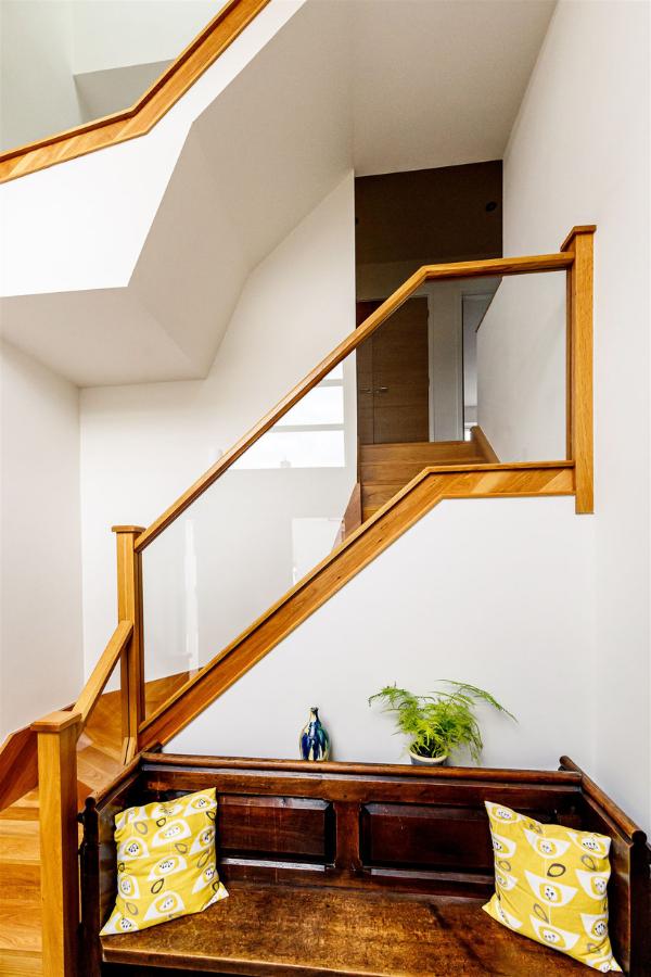 Three storey glazed and oak staircase