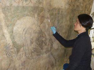 Work in progrèss repairing medieval church wall paintings